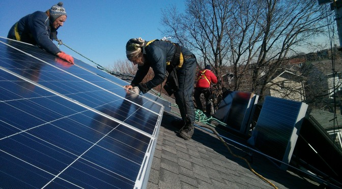 Ailey Solar - Emmet and Joe installing solar in Oak Park, winter 2013