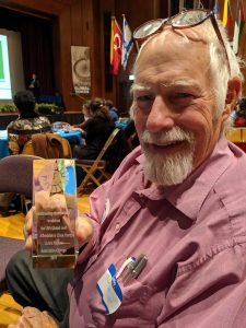Jack Ailey with UNA Chicago Award for local work in promoting affordable renewable energy.